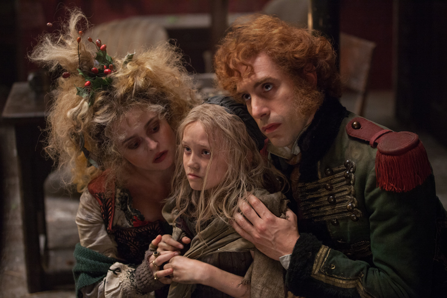 Madame Thénardier (Helena Bonham Carter) and Monsieur Thénardier (Sacha Baron Cohen) try to exploit Young Cosette (Isabelle Allen).Image: Laurie Sparham/Universal Pictures